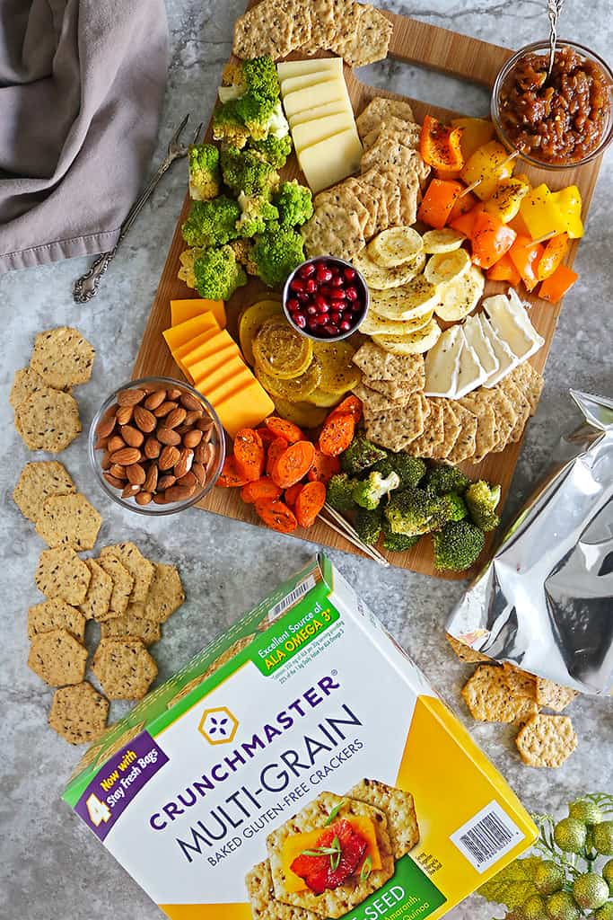 zaatar roasted veggies with Crunchmaster crackers and cheese on a platter