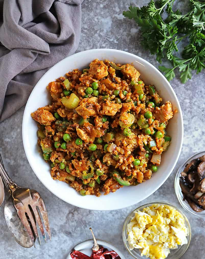 Easy Pan-Fried Chicken Cauliflower Rice Meal with toppings on the side.