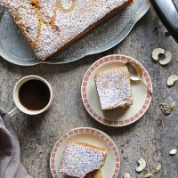 Small-batch eggless Sri Lankan Love Cake Recipe on two plates and a serving platter with a cup of coffee.