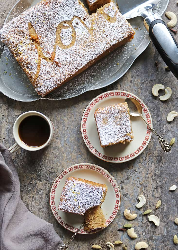 Small-batch eggless Cashew Semolina Cake AKA Sri Lankan Love Cake Recipe on two plates and a serving platter with a cup of coffee.
