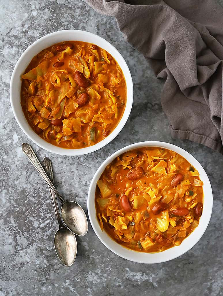 Delicious vegan melting cabbage soup in spiced coconut tomato broth