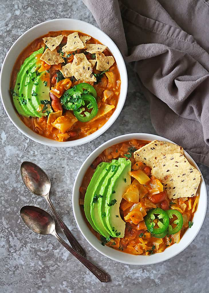 Two bowls of melt in your mouth vegan cabbage soup with beans.