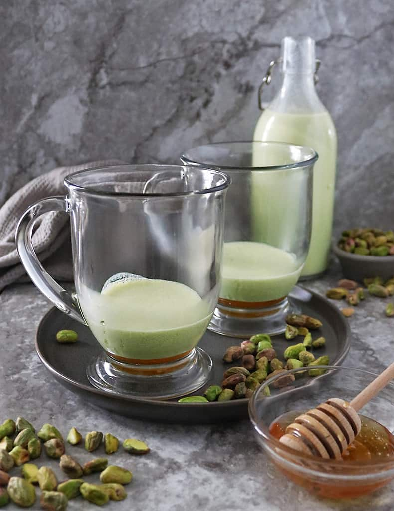 Add in frothed pistachio milk to honey in mug