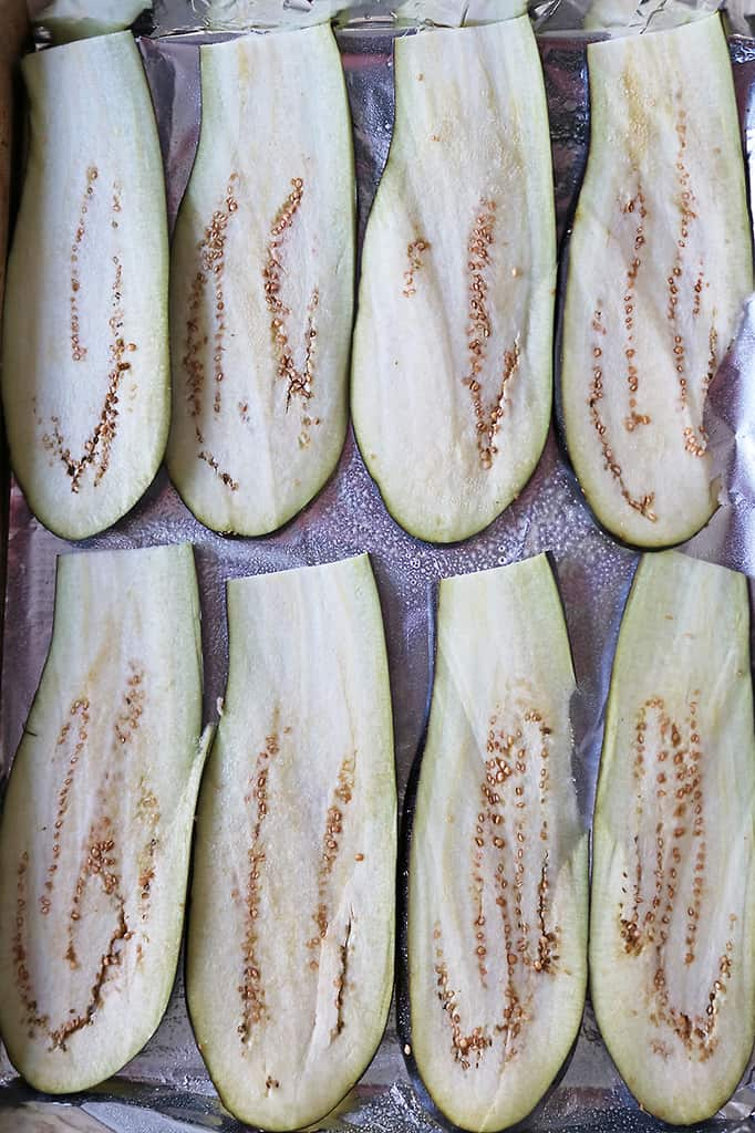 Brushing eggplant slices with oil and baking them