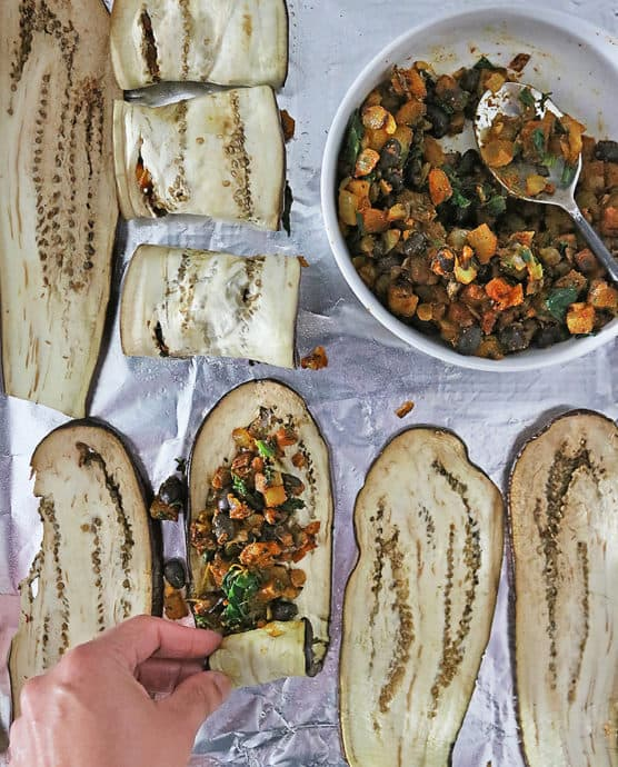 Stuffing and Rolling Eggplant Rollatini with potato filling.