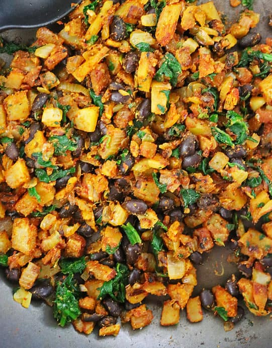 tasty vegan stuffing with potatoes, spinach, and beans.