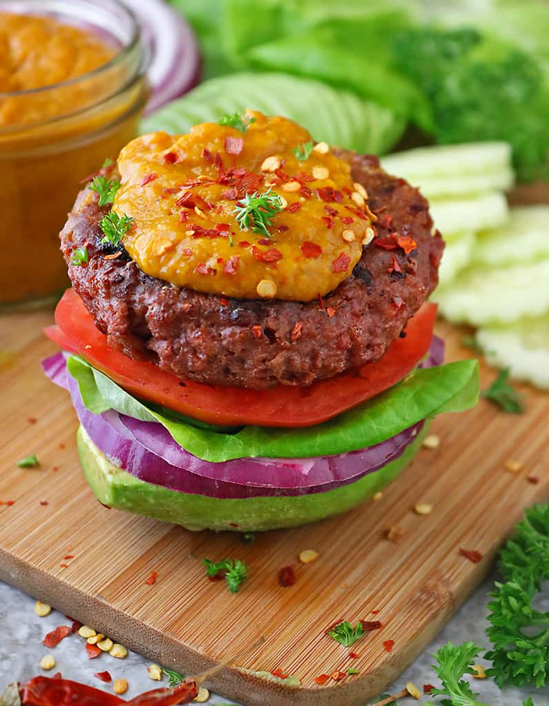 Delicious plant based Beyond Meat Burger on avocado with spicy mango sauce