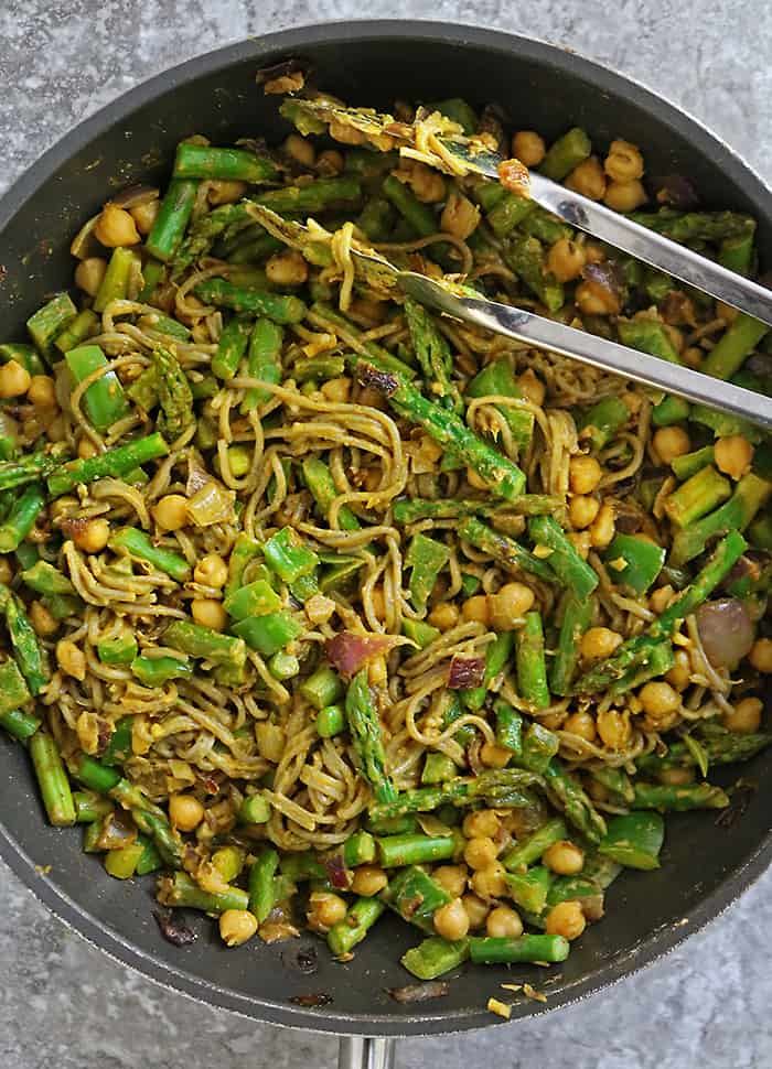 Making plant-based curry noodles for dinner