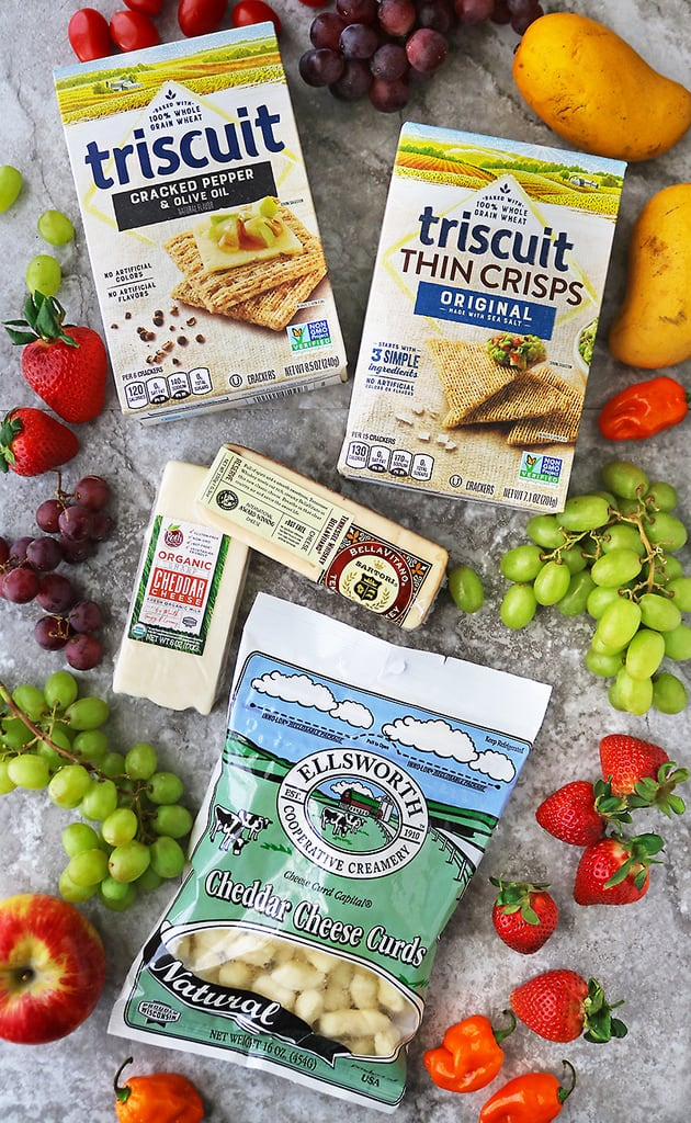 overhead photograph of Wisconsin Cheese varieties and triscuit crackers