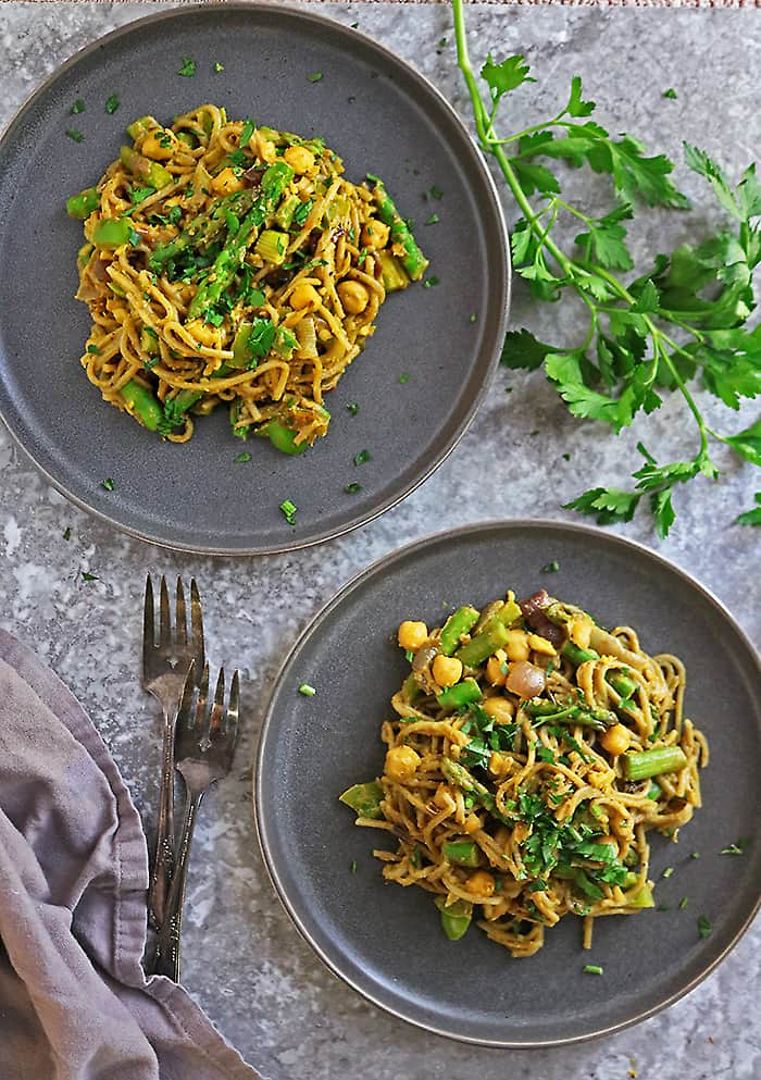 Two plates of tasty plant based curry noodles for dinner