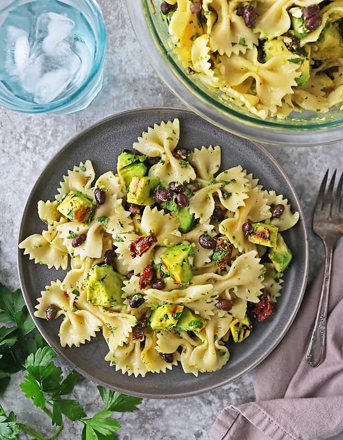Grilled Avocado Sundried Tomato Pasta Salad on a plate.
