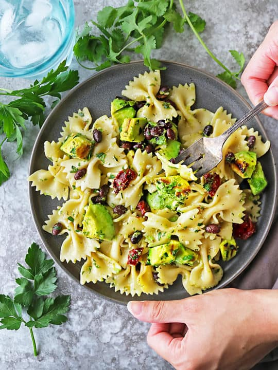 This Grilled Avocado Sundried Tomato Pasta Salad is an easy and quick meal that is incredibly flavorful thanks to grilled avocado and a lemon garlic herb dressing.