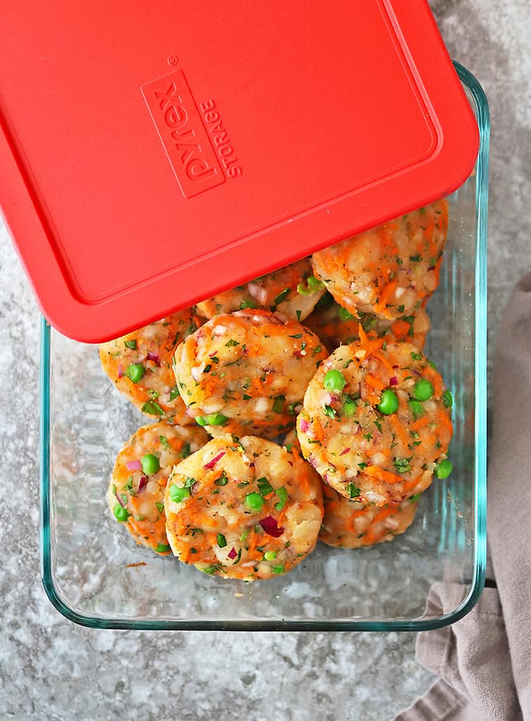 Photo with uncooked veggie fritters in Pyrex dish with cover partially on.