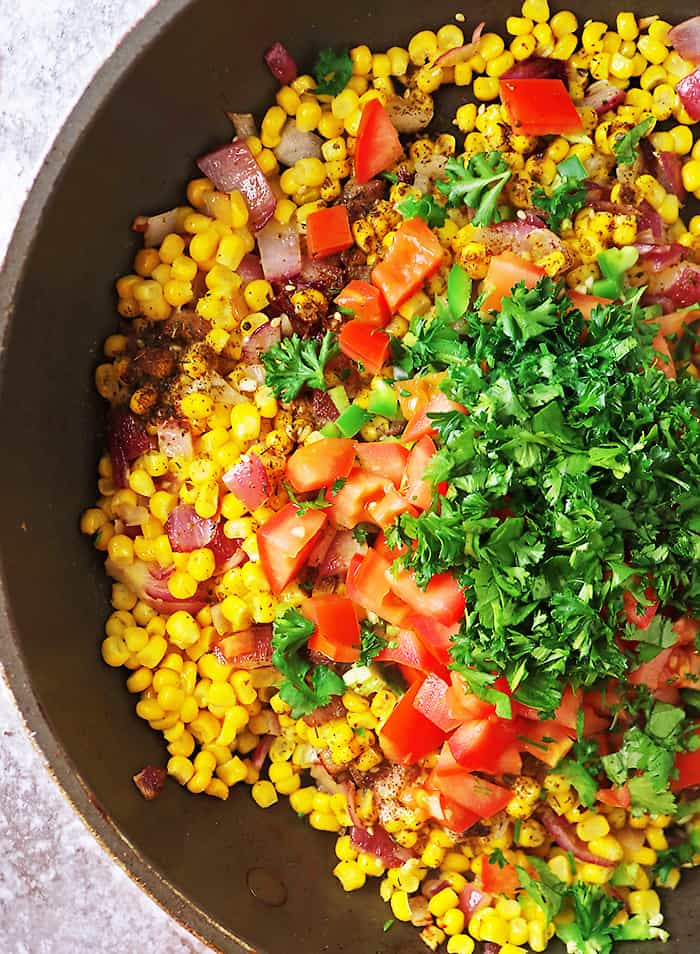 Sauteing the ingredients together for the best corn salad recipe