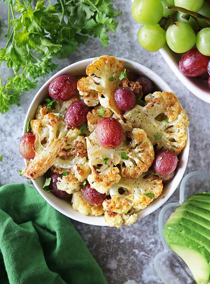 Roasted Cauliflower and Grapes with Zataar in a large bowl.