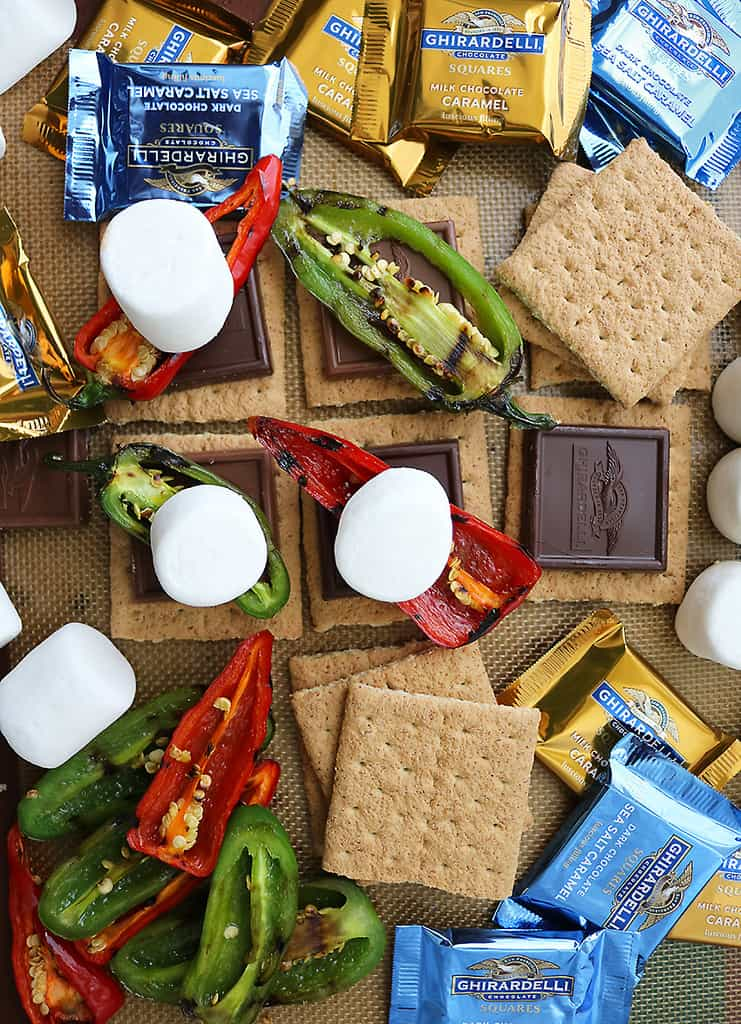 Baking tray with graham crackers, chocolate, roasted peppers and marshmallows