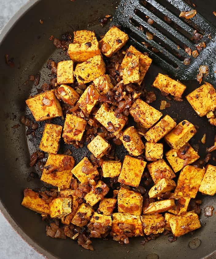 Tofu sautéed with garlic onions coriander turmeric smoked paprika.