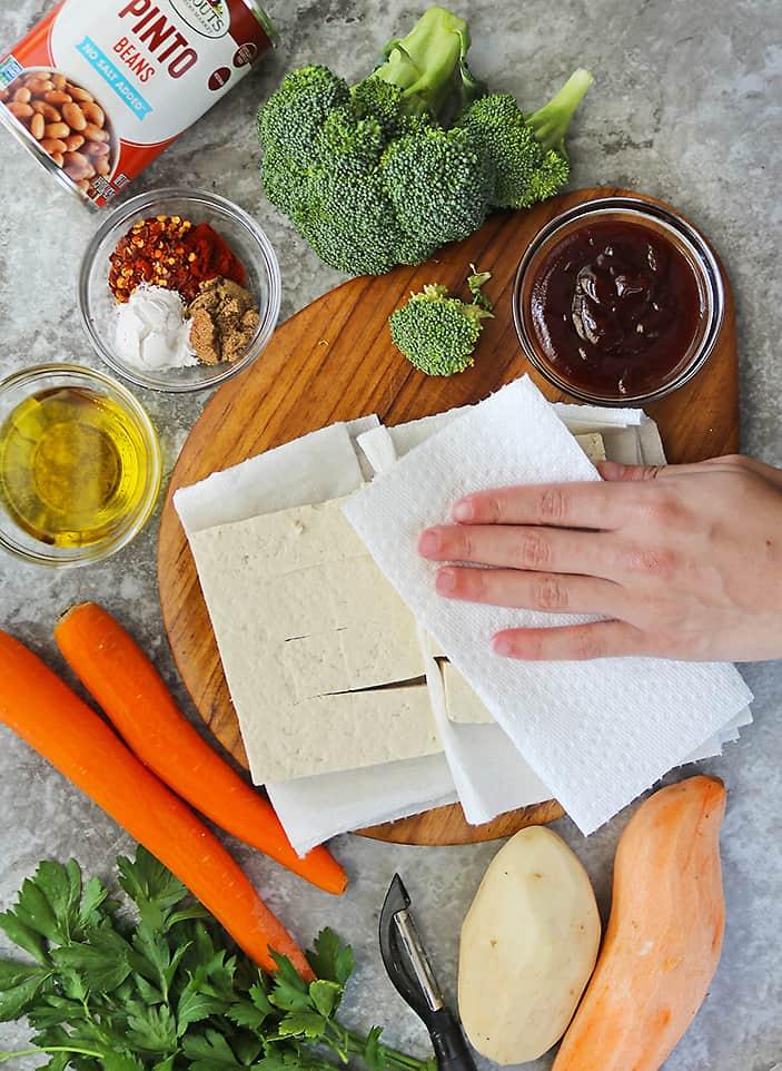 Drying tofu well before seasoning it.