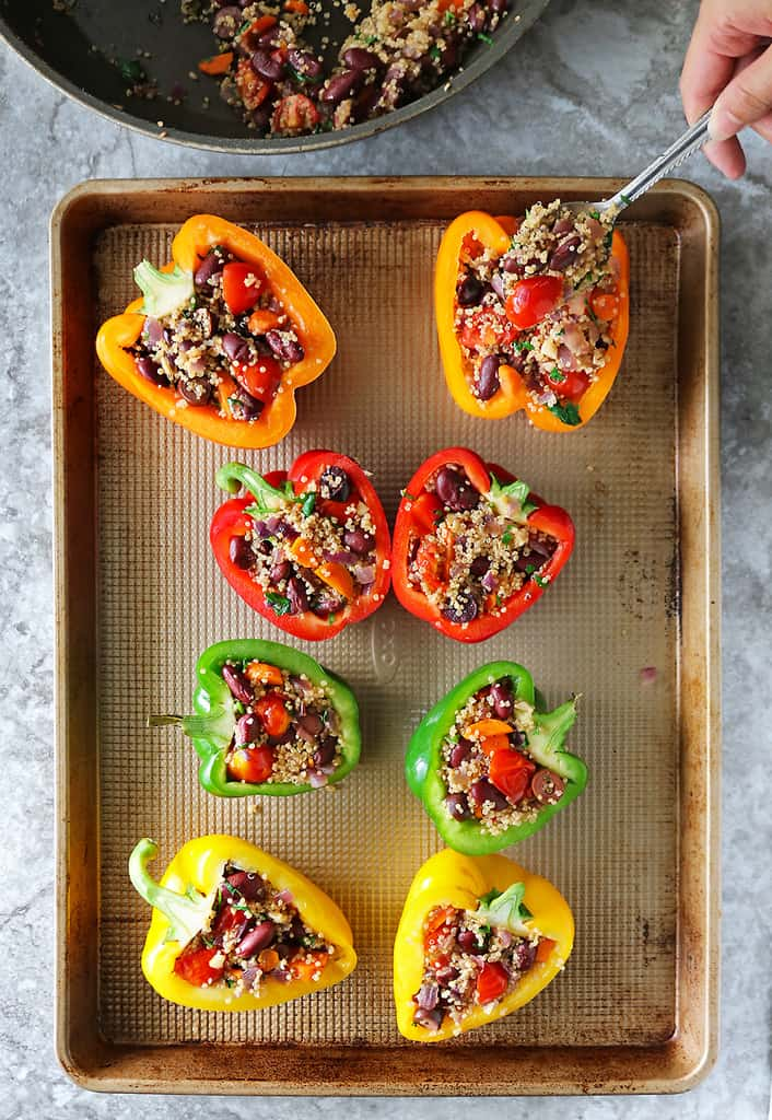 Stuffing bell peppers with quinoa bean mix