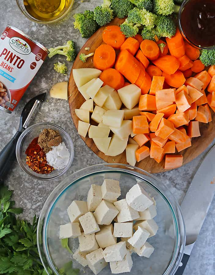 tofu and veggies cut up and ready to be seasoned before baking.