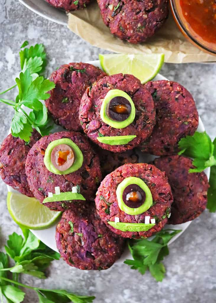 A tray with tasty and fun Vegan one eyed purple people eater fritters.