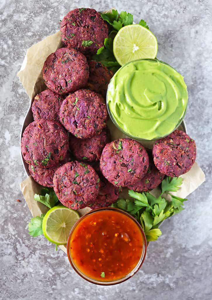Fun Vegan purple sweet potato fritters on a silver platter