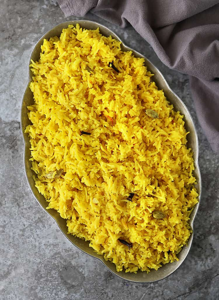 A large platter of buttery garlic Yellow rice warm and delicious